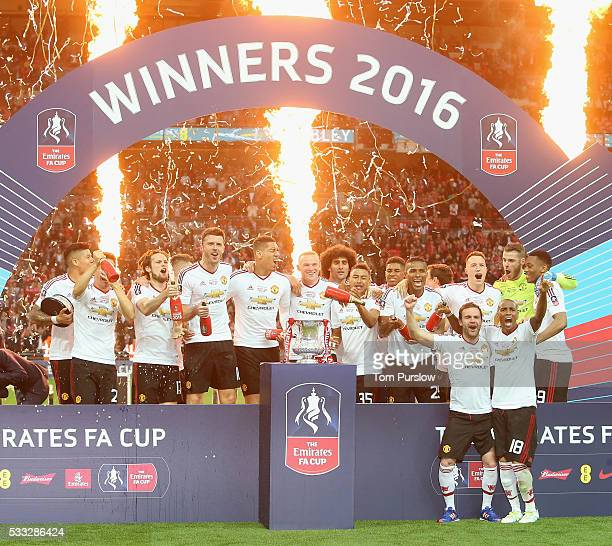 The Manchester United squad celebrate with the FA Cup trophy after The Emirates FA Cup final match between Manchester United and Crystal Palace at...