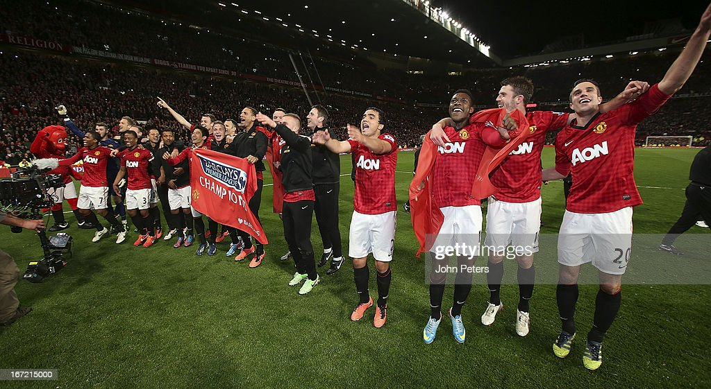 The Manchester United squad celebrates on the pitch after the Barclays Premier League match between Manchester United and Aston Villa at Old Trafford on April 22, 2013 in Manchester, England.