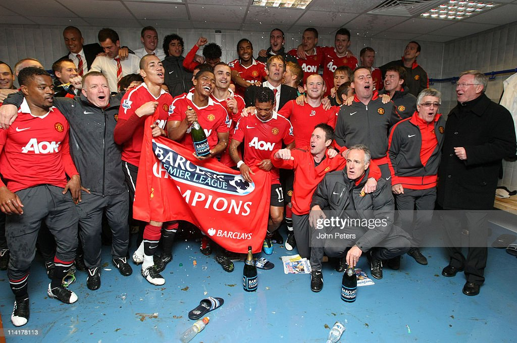 The Manchester United squad celebrates winning the Premier League title in the dressing room after the Barclays Premier League match between Blackburn Rovers and Manchester United at Ewood Park on May 14, 2011 in Blackburn, England.