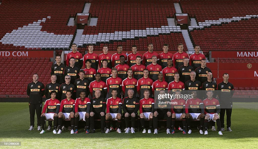 The Manchester United squad (Back Row L-R:) Chris Smalling, Jonny Evans, Phil Jones, Bebe, Robin van Persie, <a gi-track='captionPersonalityLinkClicked' href=/galleries/search?phrase=Rio+Ferdinand&family=editorial&specificpeople=157538 ng-click='$event.stopPropagation()'>Rio Ferdinand</a>, Michael Carrick, <a gi-track='captionPersonalityLinkClicked' href=/galleries/search?phrase=Nemanja+Vidic&family=editorial&specificpeople=497253 ng-click='$event.stopPropagation()'>Nemanja Vidic</a>, Federico Macheda. (Third Row L-R:) Sports Scientist Simon Wells, Head of Fitness Tony Strudwick, Shinji Kagawa, Angelo Henriquez, Danny Welbeck, Nick Powell, Darren Fletcher, Nani, Assistant Kit Manager Alec Wylie, Masseur Rod Thornley. (Second Row L-R:) Masseur Andy Caveney, Masseur Gary Armer, Kit Manager Albert Morgan, Doctor Steve McNally, Antonio Valencia, Anders Lindegaard, David de Gea, Sam Johnstone, Ashley Young, Alexander Buttner, Goalkeeping Coach Eric Steele, Physio Rob Swire, Physio Neil Hough. (Front Row L-R:) Rafael Da Silva, Javier 'Chicharito' Hernandez, Anderson, Assistant Manager Mike Phelan, Ryan Giggs, Manager Sir <a gi-track='captionPersonalityLinkClicked' href=/galleries/search?phrase=Alex+Ferguson&family=editorial&specificpeople=203067 ng-click='$event.stopPropagation()'>Alex Ferguson</a>, Paul Scholes, First Team Coach Rene Meulensteen, Tom Cleverley, Patrice Evra, <a gi-track='captionPersonalityLinkClicked' href=/galleries/search?phrase=Wayne+Rooney&family=editorial&specificpeople=157598 ng-click='$event.stopPropagation()'>Wayne Rooney</a> pose at the annual club photocall at Old Trafford on August 31, 2012 in Manchester, England.