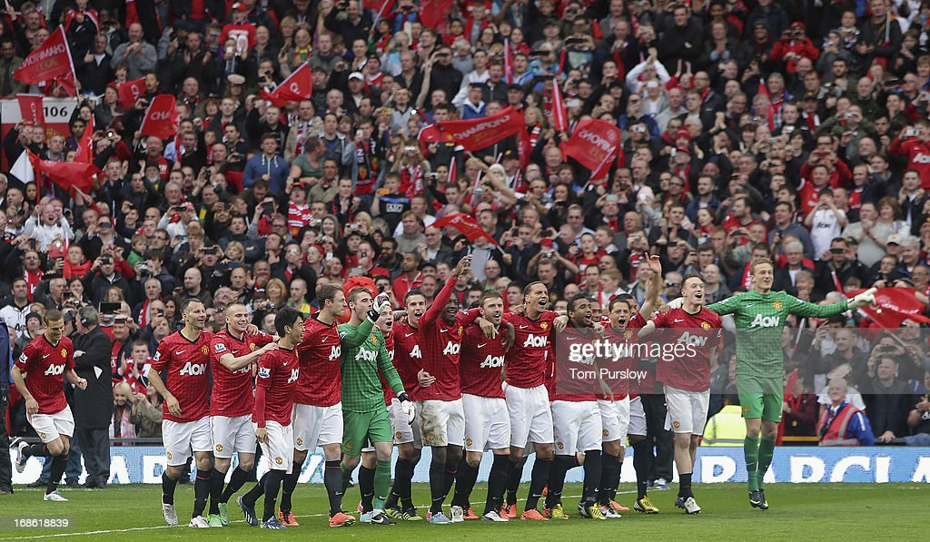The Manchester United squad come out to lift the Premier League trophy after the Barclays Premier League match between Manchester United and Swansea at Old Trafford on May 12, 2013 in Manchester, England.