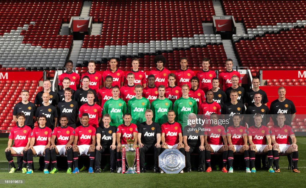 The Manchester United squad (Back Row L-R:) Danny Welbeck, Phil Jones, Chris Smalling, Jonny Evans, Marouane Fellaini, Rio Ferdinand, Michael Carrick, Robin van Persie (Third Row L-R:) Masseur Garry Armer, Performance Analyst Paul Brand, Head of Fitness Tony Strudwick, Antonio Valencia, Darren Fletcher, Wilfried Zaha, Adnan Januzaj, Fabio da Silva, Masseur Rod Thornley, Kit Manager Alec Wylie, Physio Neil Hough (Second Row L-R:) Assistant Kit Manager Ian Buckingham, Physio Rob Swire, Dr Steve McNally, Alexander Buttner, Sam Johnstone, Anders Lindegaard, David de Gea, Ben Amos, Ashley Young, Coach Phil Neville, Masseur Andy Caveney, Goalkeeping Coach Chris Woods. (Front Row L-R:) Shinji Kagawa, Rafael da Silva, Anderson, Nani, Assistant Manager Steve Round, Ryan Giggs, Manager David Moyes, Nemanja Vidic, Coach Jimmy Lumsden, Patrice Evra, Javier 'Chicharito' Hernandez, Tom Cleverley and Wayne Rooney pose at the annual club photocall at Old Trafford on September 26, 2013 in Manchester, England.