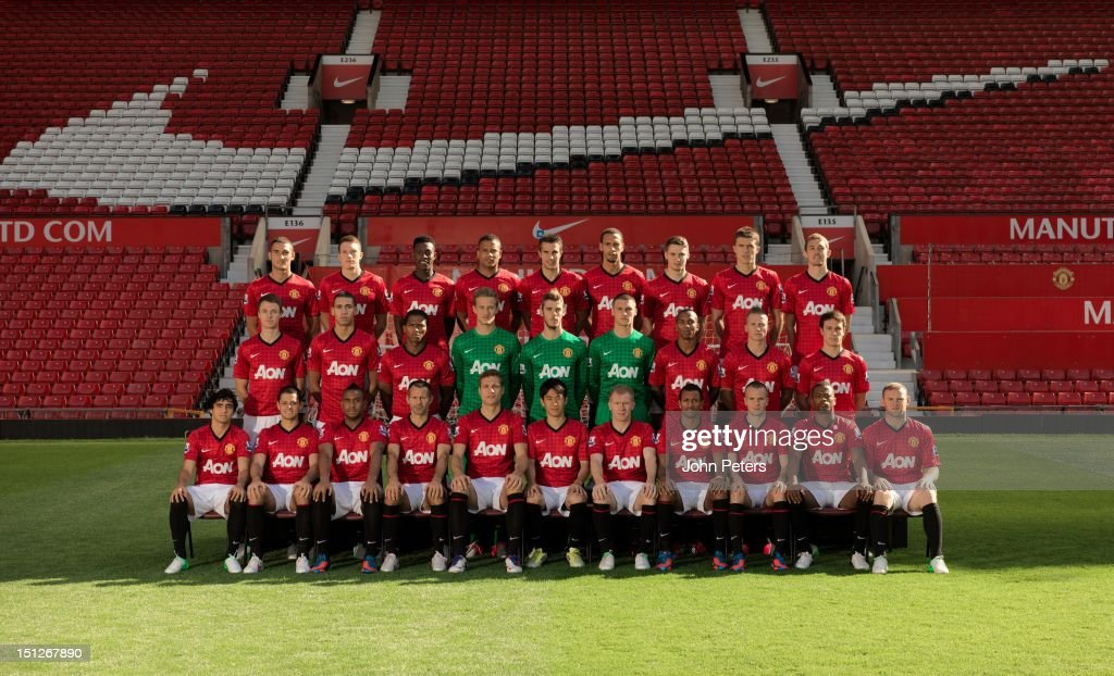 The Manchester United squad (Back Row L-R:) Federico Macheda, Phil Jones, Danny Welbeck, Bebe, Robin van Persie, Rio Ferdinand, Nick Powell, Michael Carrick, Darren Fletcher (Middle Row L-R:) Jonny Evans, Chris Smalling, Antonio Valencia, Anders Lindegaard, David de Gea, Sam Johnstone, Ashley Young, Alexander Buttner, Angelo Henriquez. (Front Row L-R:) Rafael Da Silva, Javier 'Chicharito' Hernandez, Anderson, Ryan Giggs, Nemanja Vidic, Shini Kagawa, Paul Scholes, Nani, Tom Cleverley, Patrice Evra, Wayne Rooney pose at the annual club photocall at Old Trafford on August 31, 2012 in Manchester, England.