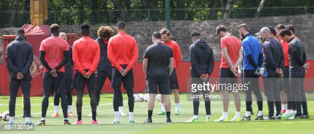 The Manchester United squad hold a minute's silence in honour of the victims of the attack at Manchester Arena ahead of a first team training session...