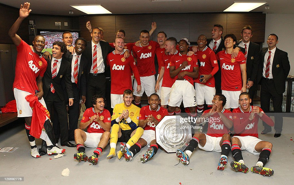 The Manchester United squad pose in the dressing room with the Community Shield trophy after the FA Community Shield match between Manchester City and Manchester United at Wembley Stadium on August 7, 2011 in London, England.