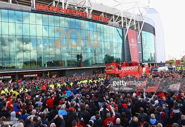 The Manchester United squad pose on an opentop bus at the start of their Barclays Premier League Trophy Parade through Manchester on May 13 2013 in...