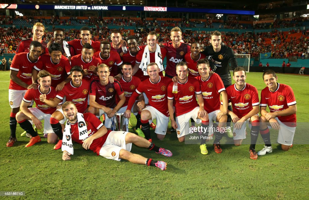 The Manchester United squad pose with the International Champions Cup trophy after the pre-season friendly match between Manchester United and Liverpool at Sun Life Stadium on August 4, 2014 in Miami Gardens, Florida.