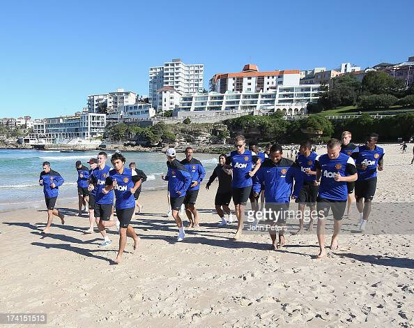 The Manchester United squad runs at Bondi Beach as part of their preseason tour of Bangkok Australia Japan China and Hong Kong on July 21 2013 in...