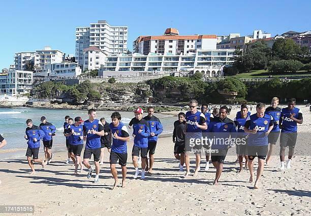 The Manchester United squad runs at Bondi Beach as part of their preseason tour of Bangkok Australia Japan China and Hong Kong on July 21 2013 in...
