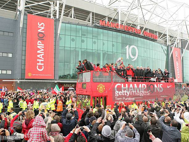 The Manchester United squad show off the Barclays Premier League trophy during the Manchester United Premier League Winners Parade on May 30 2011 in...