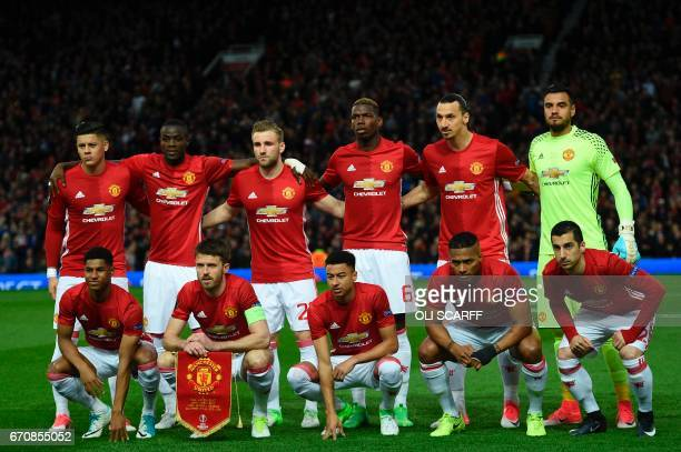 The Manchester United starting XI pose for the team picture Manchester United's Argentinian defender Marcos Rojo Manchester United's Ivorian defender...