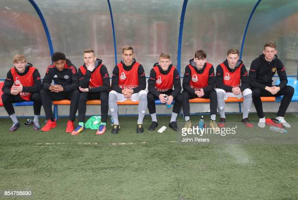 The Manchester United substitutes sit on the bench ahead of the UEFA Youth League match between CSKA Moskva U19s and Manchester United U19s at...