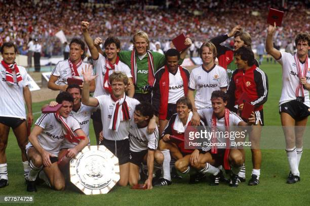 The Manchester United team celebrate with the Charity Shield after beating Liverpool 20 Ray Wilkins Mike Duxbury Bryan Robson Gary Bailey Remi Moses...