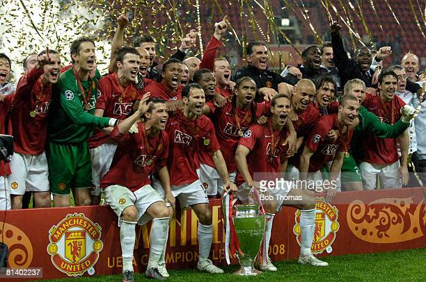 The Manchester United team celebrate with the trophy after winning the UEFA Champions League Final between Manchester United and Chelsea held at the...