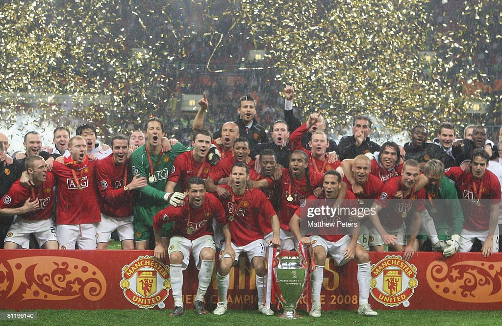 The Manchester United team celebrates with the trophy after winning the UEFA Champions League Final match between Manchester United and Chelsea at Luzhniki Stadium on May 21 2008 in Moscow, Russia.
