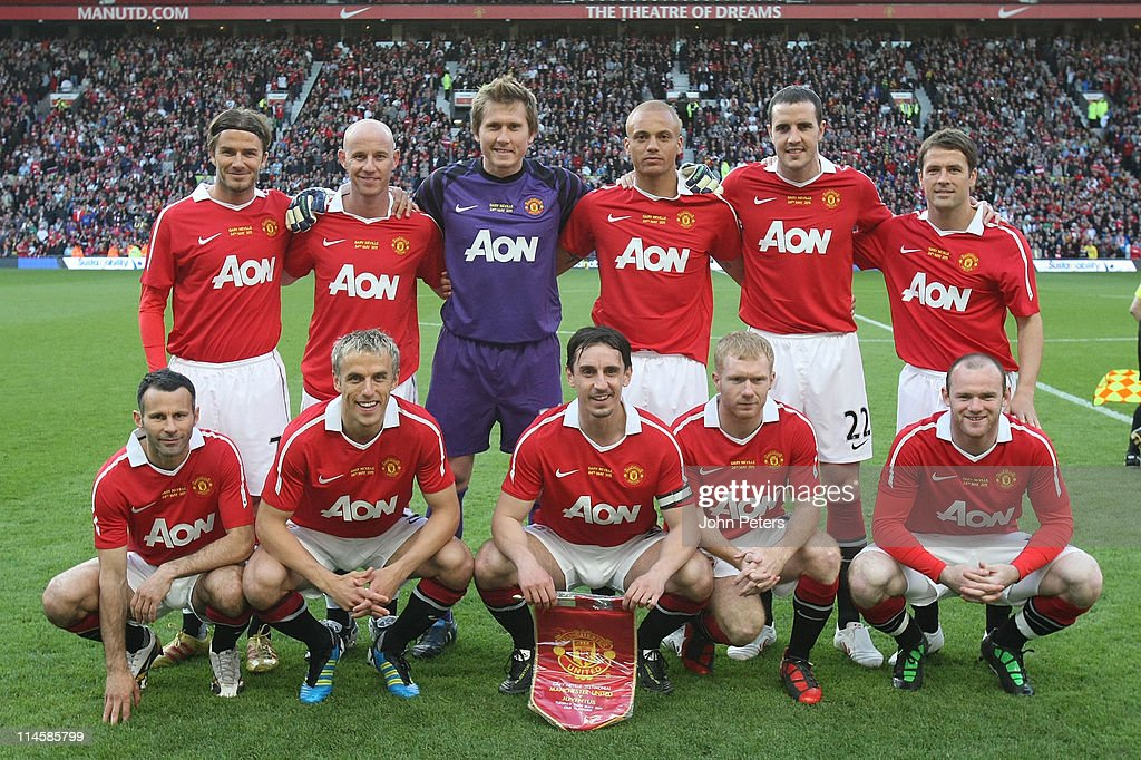 The Manchester United team (Back Row L-R David Beckham, Nicky Butt, Tomasz Kuszczak, Wes Brown, John O'Shea, Michael Owen. Front Row L-R Ryan Giggs, Phil Neville, Gary Neville, Paul Scholes, Wayne Rooney) line up ahead of testimonial match between Manchester United and Juventus at Old Trafford on May 24, 2011 in Manchester, England.