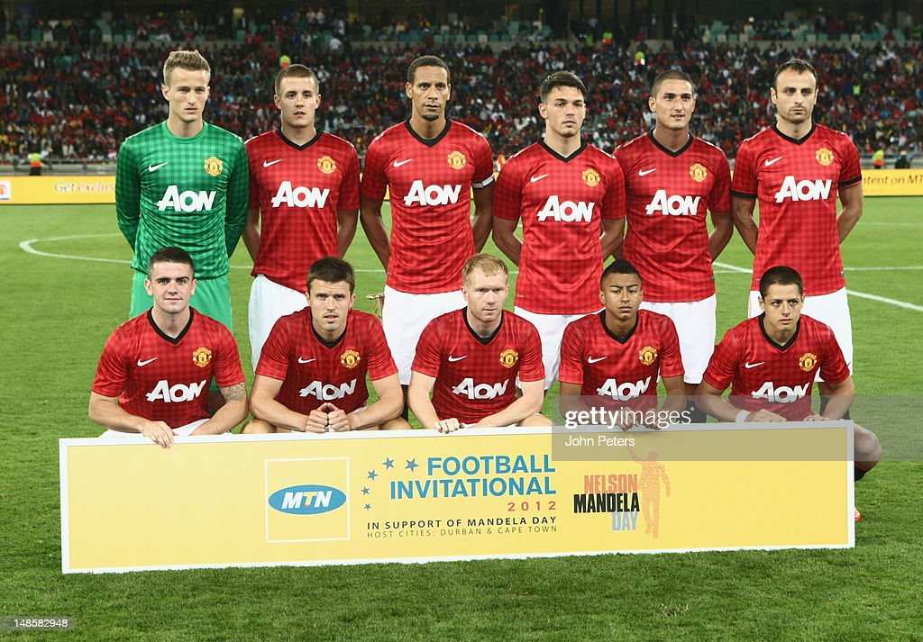 The Manchester United team (Back Row L-R Anders Lindegaard, Scott Wootton, Rio Ferdinand, Frederic Veseli, Federico Macheda, Dimitar Berbatov, Front Row L-R Robert Brady, Michael Carrick, Paul Scholes, Jesse Lingard and Javier Hernandez) line up ahead of the pre-season friendly between AmaZulu FC and Manchester United at Moses Mabhida Stadium on July 18, 2012 in Durban, South Africa.