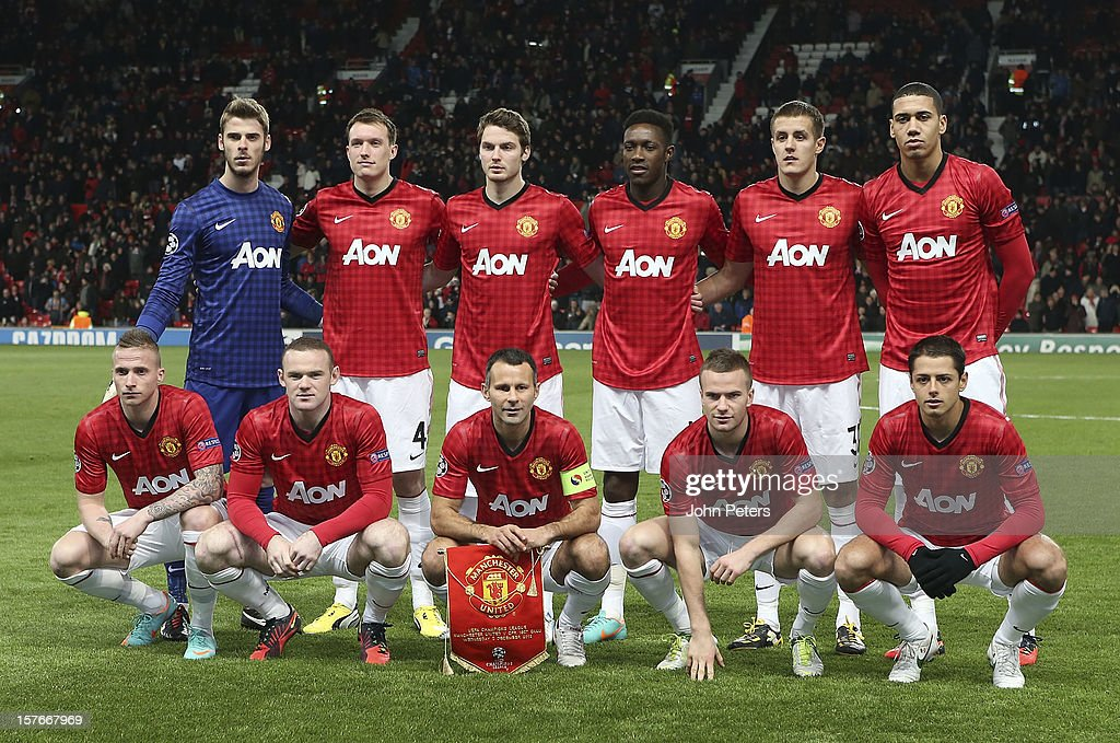 The Manchester United team (Back Row L-R: David de Gea; Phil Jones, Nick Powell, Danny Welbeck, Scott Wootton, Chris Smalling. Front Row L-R: Alexander Buttner, Wayne Rooney, Ryan Giggs, Tom Cleverley, Javier 'Chicharito Hernandez) line up ahead of the UEFA Champions League Group H match between Manchester United and CFR 1907 Cluj at Old Trafford on December 5, 2012 in Manchester, England.