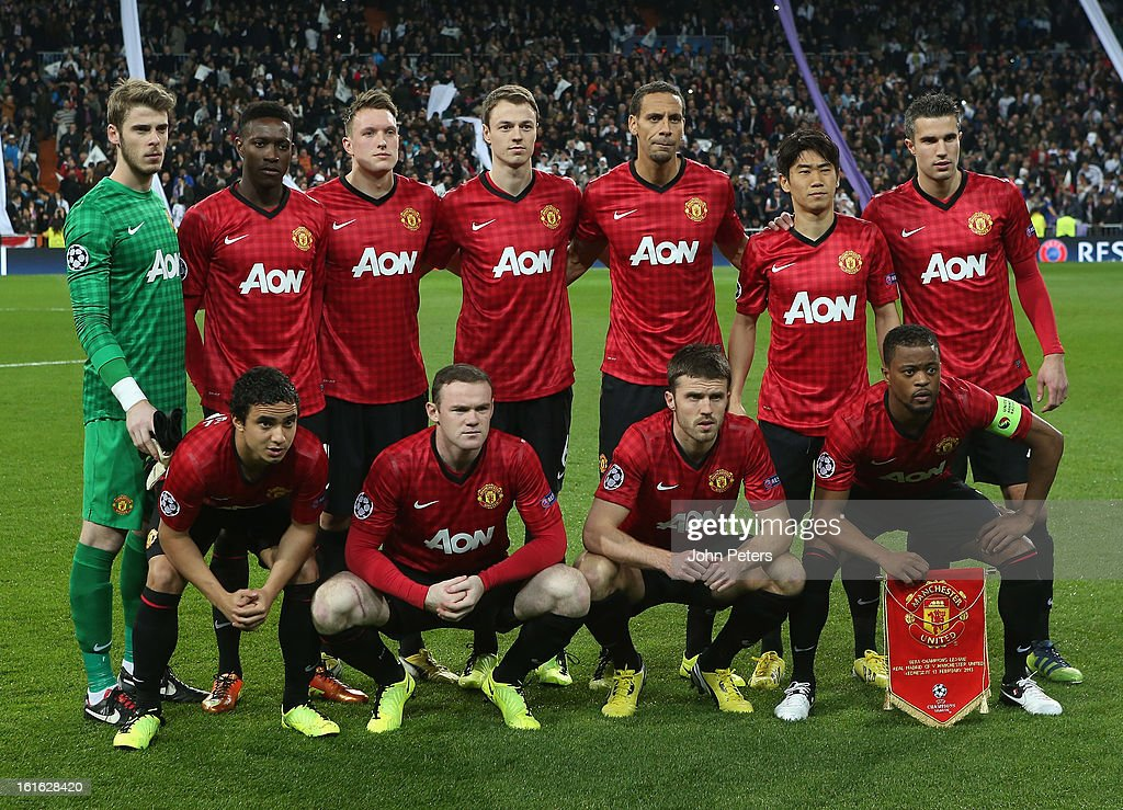 The Manchester United team (Back row L-R: David de Gea, Danny Welbeck, Phil Jones, Jonny Evans, Rio Ferdinand, Shinji Kagawa, Robin van Persie. Front row L-R: Rafael da Silva, Wayne Rooney, Michael Carrick, Patrice Evra) line up ahead of the UEFA Champions League Round of 16 first leg match between Real Madrid and Manchester United at Estadio Santiago Bernabeu on February 13, 2013 in Madrid, Spain.