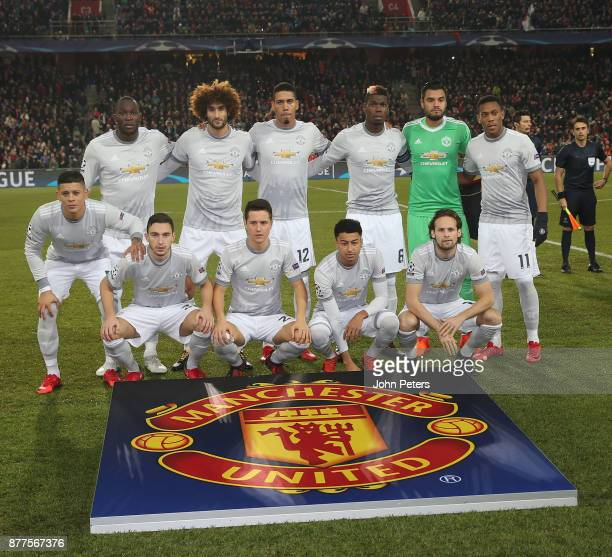 The Manchester United team line up ahead of the UEFA Champions League group A match between FC Basel and Manchester United at St JakobPark on...