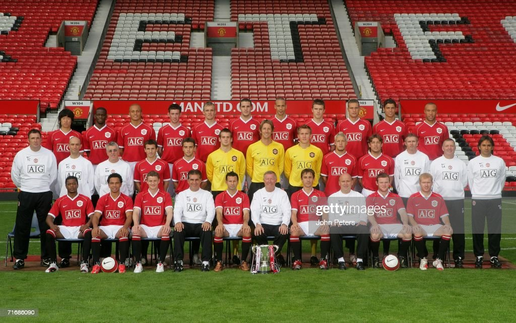 The Manchester United team line up during the official team photocall at Old Trafford on August 21 2006 in Manchester, England. Back Row (L-R): Ji-Sung Park, Louis Saha, Wes Brown, David Jones, Darren Fletcher, John O'Shea, Rio Ferdinand, Michael Carrick, Nemanja Vidic, Cristiano Ronaldo, Mikael Silvestre. Middle Row (L-R): Goalkeeping coach Tony Coton, Physio Rob Swire, Kit Manager Albert Morgan, Liam Miller, Giuseppe Rossi, Tom Heaton, Edwin van der Sar, Tomasz Kuszczak, Alan Smith, Gabriel Heinze, Assistant Kit Manager Alec Wylie, Masseur Gary Armer, Fitness Coach Valter di Salvo. Front Row (L-R): Patrice Evra, Kieran Richardson, Ole Gunnar Solskjaer, Assistant Manager Carlos Queiroz, Ryan Giggs, Manager Sir Alex Ferguson, Gary Neville, First Team Coach Mike Phelan, Wayne Rooney, Paul Scholes.