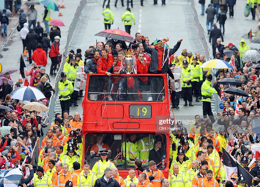 The Manchester United team make their way up Deansgate in Manchester during the Manchester United Premier League Winners Parade on May 30, 2011 in Manchester, England