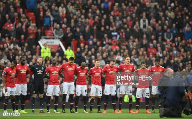The Manchester United team take part in a minute of silence prior to the Premier League match between Manchester United and Tottenham Hotspur at Old...