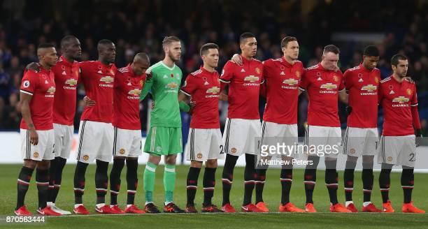 The Manchester United team take part in a minute's silence for those killed in conflict ahead of the Premier League match between Chelsea and...