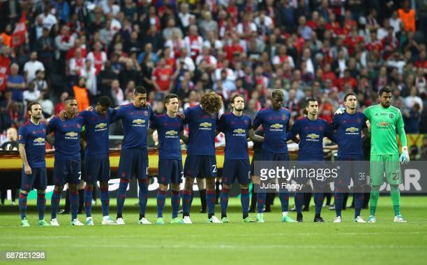 The Manchester United team take part in a minutes silence in memory of the victims of the Manchester Concert attack prior to the UEFA Europa League...