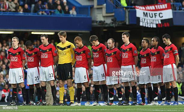 The Manchester United team take part in a minute's silence on Remembrance Sunday during the Barclays Premier League match between Chelsea and...