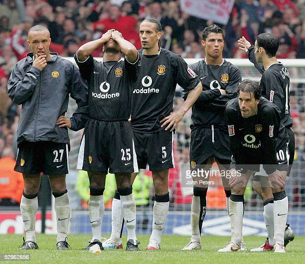 The Manchester United team watch during the penalty shootout during the FA Cup Final match between Arsenal and Manchester United at the Millennium...