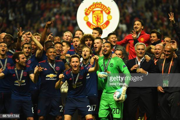 The Manchester United tem and staff celebrate with The Europa League trophy after the UEFA Europa League Final between Ajax and Manchester United at...