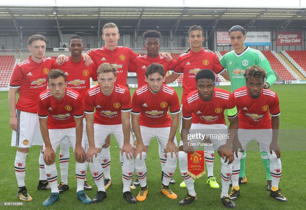 The Manchester United U19s team (Back Row L-R: Indy Boonen, Josh Bohui, Ethan Hamilton, Ethan Laird, Tom Sang, Ilias Moutha-Sebtaoui. Front Row L-R: Lee O'Connor, George Tanner, Aidan Barlow, Tyrell Warren, Angel Gomes) line up ahead of the UEFA Youth League match between Manchester United U19s and FC Basel U19s at Leigh Sports Village on September 12, 2017 in Leigh, Greater Manchester.