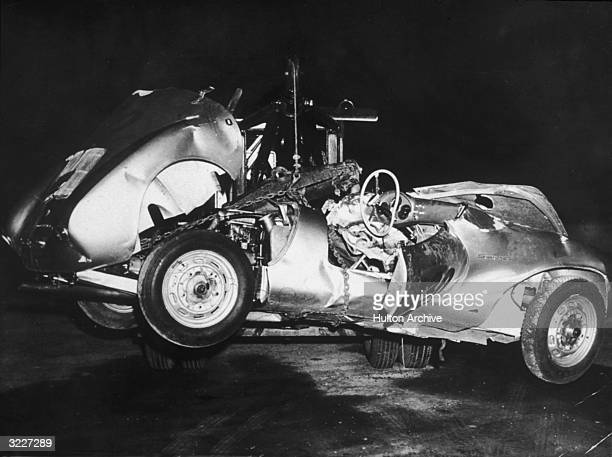 The mangled remains of 'Little Bastard' James Dean's Porsche Spyder sports car in which he died during a highspeed car crash being towed by a tow...