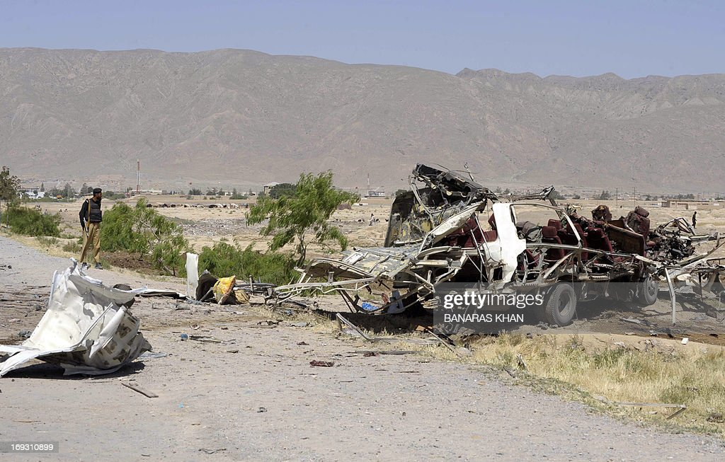 The mangled wreckage of a Pakistani security forces vehicle is seen following a bomb explosion on the outskirts of Quetta, the capital of restive Baluchistan province, on May 23, 2013. A bomb planted in a rickshaw tore through a vehicle used by security forces in southwest Pakistan on May 23, killing at least 12 people, police said.