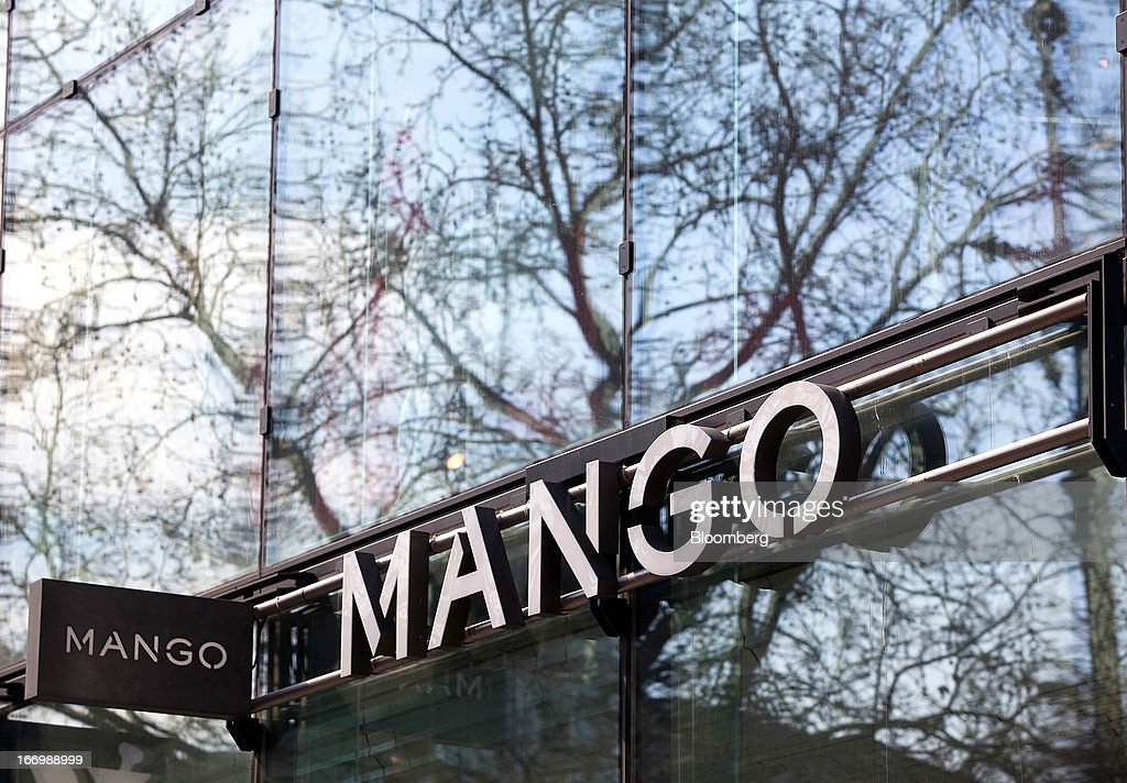 The Mango logo sits outside the fashion store in Berlin, Germany, on Thursday, April 18, 2013. Germany's economy is shrugging off a contraction at the end of last year and starting to grow due to revived exports and rising private consumption, the country's leading economic institutes said. Photographer: Krisztian Bocsi/Bloomberg via Getty Images