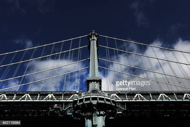 The Manhattan Bridge rises from a park in Brooklyn on February 16 2017 in New York City An annual report by the American Road and Transportation...
