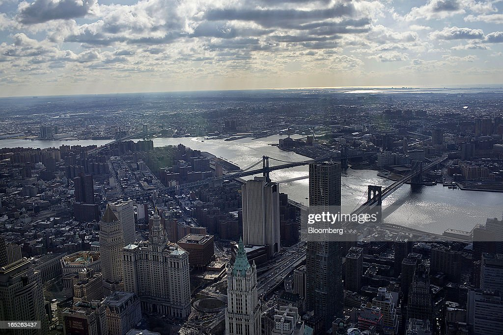 The Manhattan skyline is seen from the One World Trade Center observation deck in New York, U.S., on Tuesday, April 2, 2013. The observation deck at One World Trade Center, expected to open in 2015, will occupy the tower's 100th through 102nd floors. Guests visiting the observation deck will see a 'pre-show' about the creation of the building while waiting in line in the lobby. Photographer: Victor J. Blue/Bloomberg via Getty Images