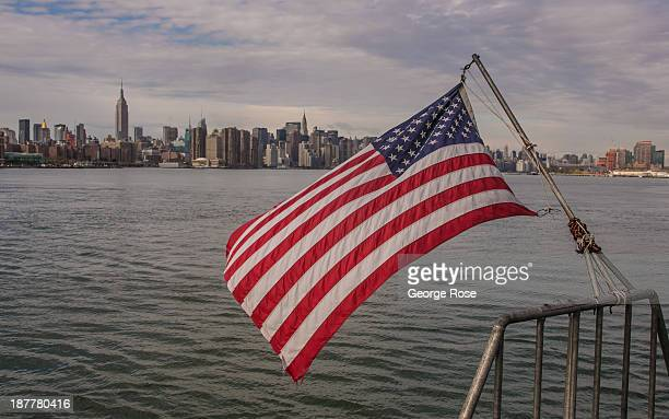 The Manhattan skyline is viewed during a ride on the East River Ferry on October 24 2013 in New York City With a full schedule of conventions and...
