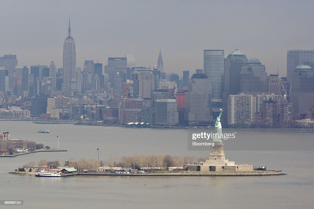 The Manhattan skyline stands beyond the Statue of Liberty as viewed from an A-star 350 B-2 helicopter made by Eurocopter SA, one of six in the fleet of Liberty Helicopters Inc., as it flies over New York Harbor in New York, U.S., on Thursday, March 25, 2010. Liberty Helicopters Inc. is offering to fly weary commuters from New Jersey to Manhattan for about $200 a day, saving them 14 hours in traffic a week and signaling that Wall Street may have seen the worst of the recession. Photographer: Daniel Acker/Bloomberg via Getty Images