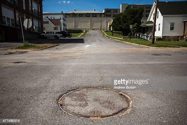 The manhole used by two convicted murderers to escape Clinton Correctional Facility is seen on June 17 2015 in Dannemora New York After conducting a...