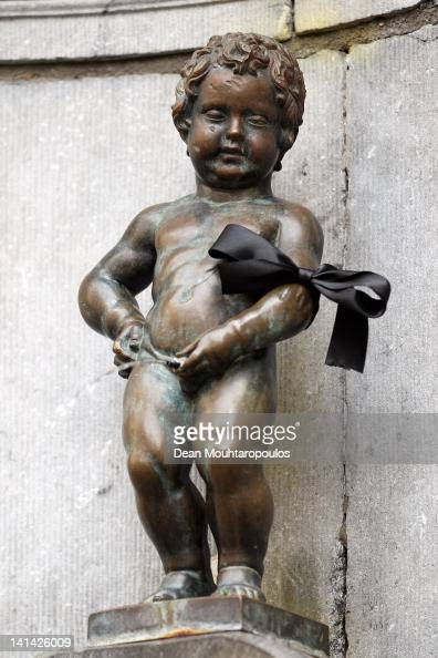 The Manneken Pis statue wears a black arm band in the city centre during a national day of mourning on March 16 2012 in Heverlee Belgium Belgium held...
