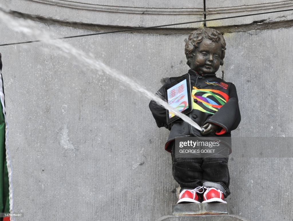 The Manneken-Pis fountain in Brussels sports on July 6, 2012 a traditional Hong Kong costume in Brussels. It is the first time the bronze boy that pees into a fountain wears such a costume, including a traditional Zhongshan suit and a clipboard under his arm.