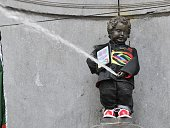 The MannekenPis fountain in Brussels sports on July 6 2012 a traditional Hong Kong costume in Brussels It is the first time the bronze boy that pees...