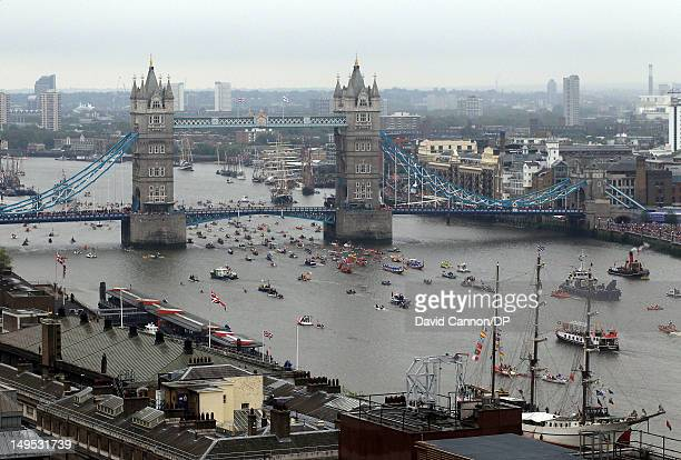 The manpowered section of the flotilla pass under Tower Bridge as seen from The Monument as they participate in The Diamond Jubilee Pageant on the...