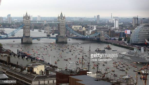 The manpowered section of the flotilla pass under Tower Bridge lead by the rowbarge Gloriana as seen from The Monument as they participate in The...