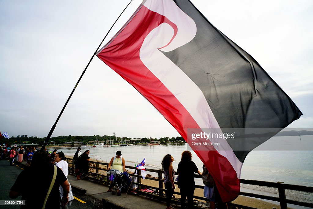The Maori flag is marched along the waterfront on February 6, 2016 in Waitangi, New Zealand. The Waitangi Day national holiday celebrates the signing of the treaty of Waitangi on February 6, 1840 by Maori chiefs and the British Crown, that granted the Maori people the rights of British Citizens and ownership of their lands and other properties.