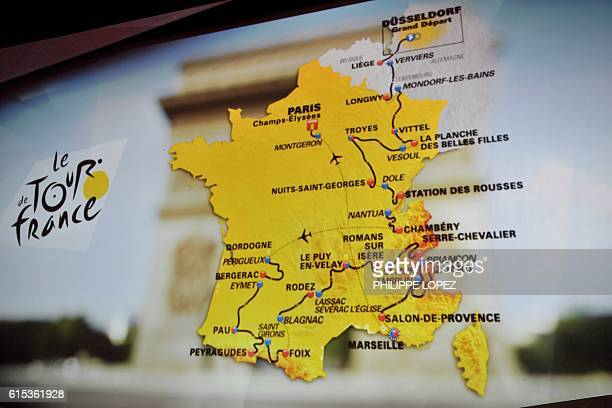 The map of the official route of the 2017 edition of the Tour de France cycling race is displayed on a giant screen in Paris on October 18 2016 / AFP...
