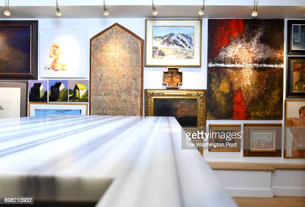 The marble waterfall counter overlooks the gallery wall in George Dant's basement apartment March 20 2017 in Washington DC
