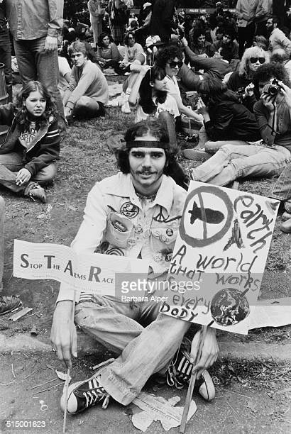 The March and Rally for Peace and Disarmament an antinuclear protest in New York City 12th June 1982 A protestor sits in Central Park with placards...